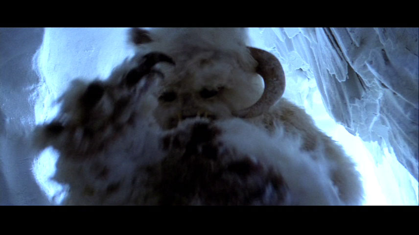 A horned wampa in its lair, finishing a meal of tauntaun.